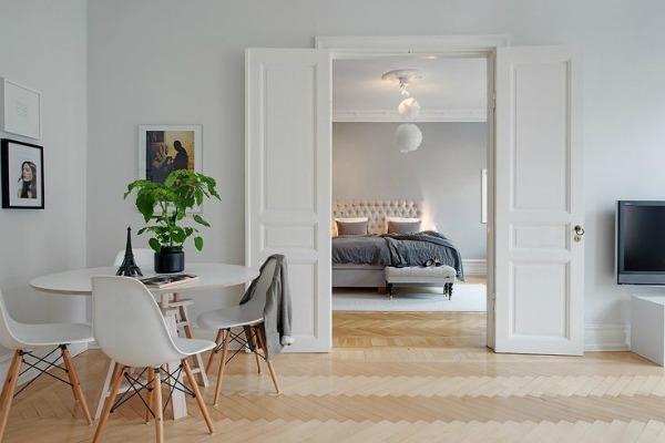 Clutter free living room looking into bedroom