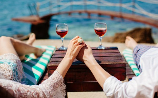 couple relax on beach holding hands together