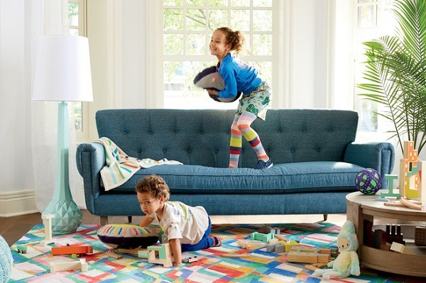 Two kids playing in the livingroom
